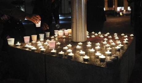 Candles commemorating the victims burned during a vigil in Oakland, Calif.